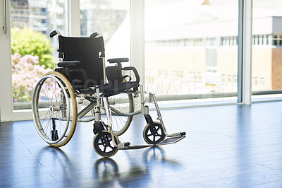 Buy stock photo Shot of a wheelchair indoors