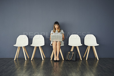 Buy stock photo Studio shot of an attractive young businesswoman waiting in line for an interview against a grey background