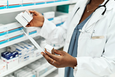 Buy stock photo High angle shot of an unrecognizable female chemist doing stock take while working in the pharmacy