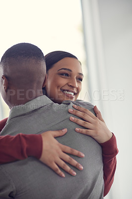 Buy stock photo Shot of a happy young couple hugging each other