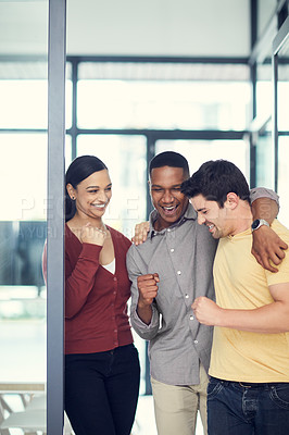Buy stock photo Shot of a group of young businesspeople celebrating in a modern office