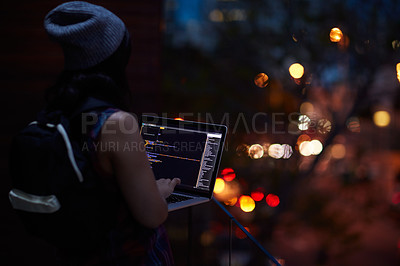 Buy stock photo Shot of a young hacker using a laptop