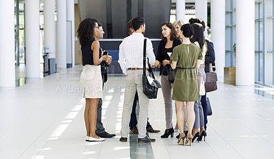 Buy stock photo Full length shot of a group of businesspeople standing in their workplace lobby
