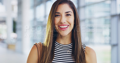 Buy stock photo Cropped shot of a confident young businesswoman working in a modern office