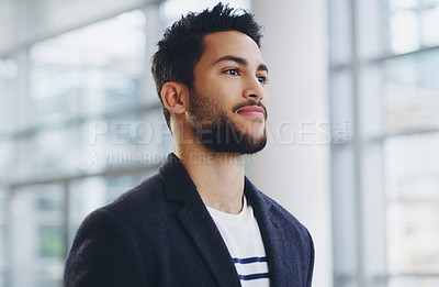 Buy stock photo Cropped shot of a young businessman showing thumbs up while walking through a modern office