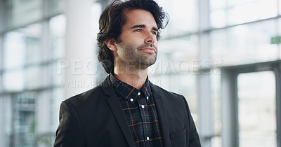 Buy stock photo Cropped shot of a confident young businessman walking through a modern office