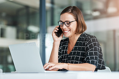 Buy stock photo Cropped shot of a happy young businesswoman taking a call while working in an office