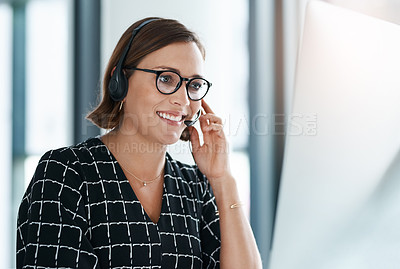 Buy stock photo Cropped shot of a happy young call centre agent working in an office