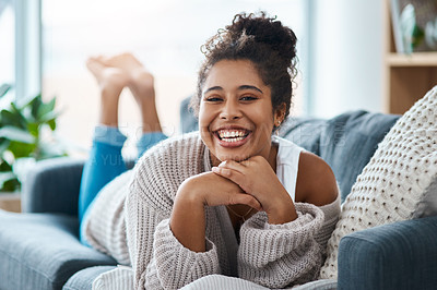 Buy stock photo Full length portrait of a happy young woman relaxing on her couch at home
