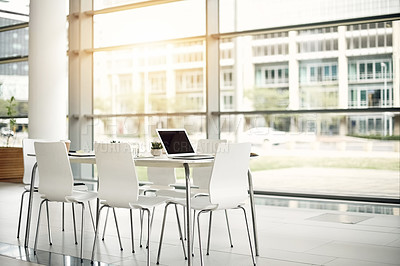 Buy stock photo Still life shot of an office space furnished with a table and chairs