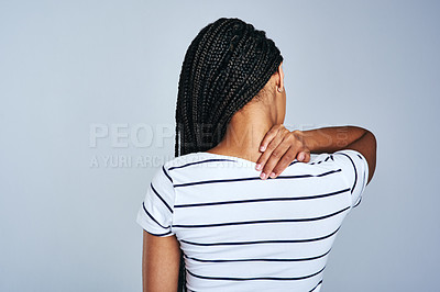 Buy stock photo Studio shot of a woman experiencing discomfort against a grey background
