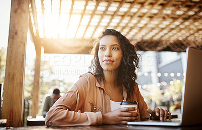 Buy stock photo Cropped shot of an attractive young woman using a laptop in a coffee shop