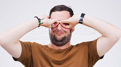 Buy stock photo Studio shot of a young man making a funny face against a gray background