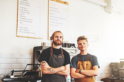 Buy stock photo Portrait of two confident young men working in a cafe