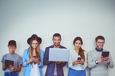Buy stock photo Cropped shot of businesspeople using their devices while waiting in line