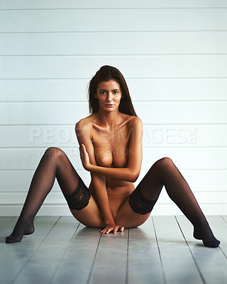 Buy stock photo Shot of an attractive young woman posing nude