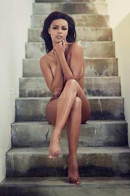 Buy stock photo Full body portrait of a beautiful young woman sitting naked on a staircase