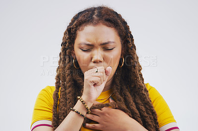 Buy stock photo Studio shot of an attractive young woman coughing against a grey background