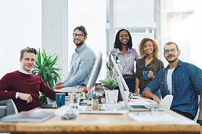 Buy stock photo Portrait of a team of young go getters working in a modern office