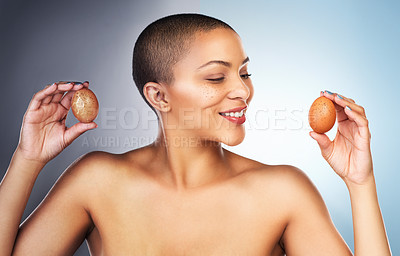 Buy stock photo Before and after concept of a young woman holding up two eggs