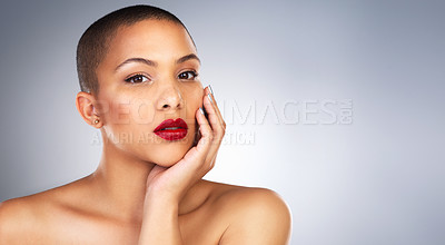 Buy stock photo Studio shot of a beautiful young woman posing with a full face of make-up