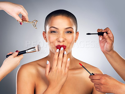 Buy stock photo Shot of hands applying makeup to a young woman's face
