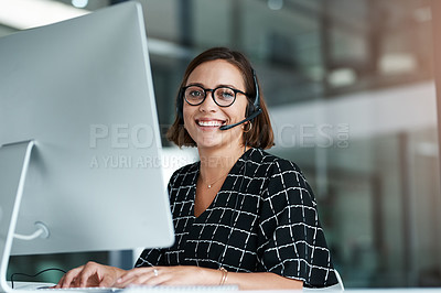 Buy stock photo Cropped portrait of a happy young call centre agent working   on a computer in an office