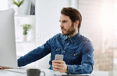 Buy stock photo Cropped shot of a young businessman working on a computer in his office