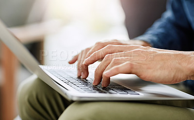 Buy stock photo Cropped shot of an unidentifiable man blogging on his computer at home
