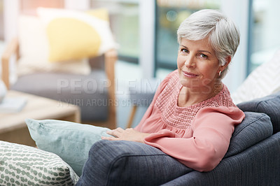 Buy stock photo Shot of a beautiful mature woman relaxing on a sofa at home