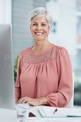 Buy stock photo Portrait of a mature businesswoman working on a computer in her office