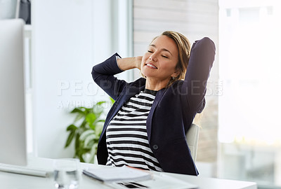 Buy stock photo Shot of an attractive businesswoman laying back and relaxing on a chair in her office at work