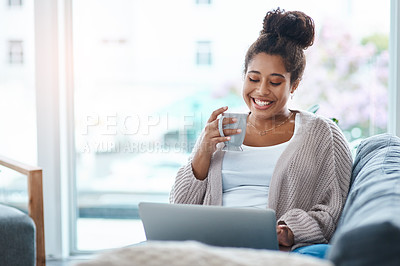 Buy stock photo Cropped shot of an attractive young woman using her laptop to make a video call at home