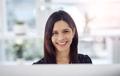 Buy stock photo Portrait of an attractive young businesswoman sitting down at her office desk at work