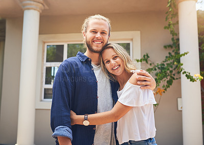 Buy stock photo Portrait of a young couple standing in front of their new home