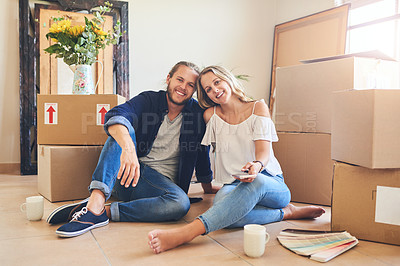 Buy stock photo Portrait of a young couple sitting on the floor while moving house