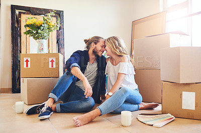 Buy stock photo Shot of a young couple sitting on the floor while moving house