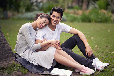 Buy stock photo Portrait of a beautiful young couple spending some time together at the park