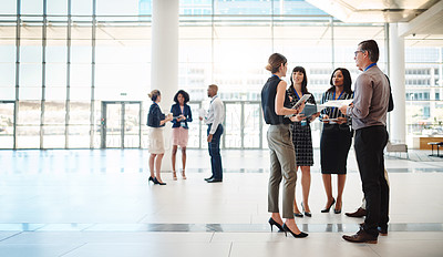 Buy stock photo Shot of businesspeople networking at a conference