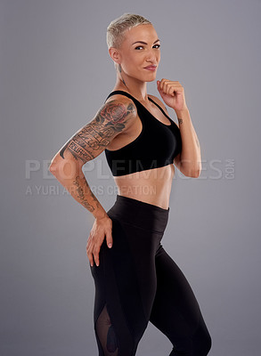 Buy stock photo Portrait of an athletic  young woman against a gray background