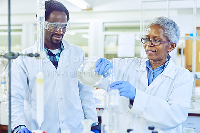 Buy stock photo Shot of two scientists working together in a lab