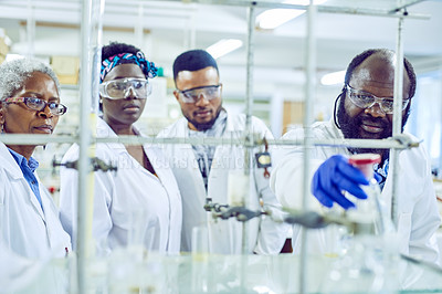 Buy stock photo Shot of a group of scientists working together in a lab