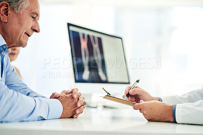 Buy stock photo Cropped shot of an unrecognizable doctor consoling with a patient inside of his office during the day