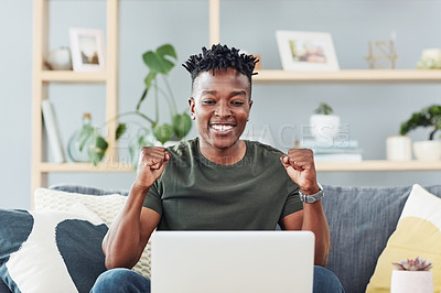 Buy stock photo Shot of a young man cheering while using a laptop at home