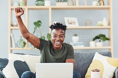 Buy stock photo Portrait of a young man cheering while using a laptop at home