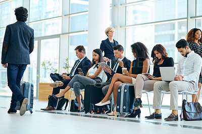 Buy stock photo Shot of a group of businesspeople seated on chairs while waiting inside of a office building during the day