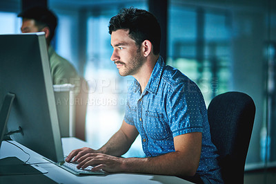 Buy stock photo Cropped shot of two young male designers working late at night in their office