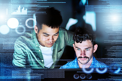Buy stock photo Cropped shot of two young male computer programmers working late at night in their office
