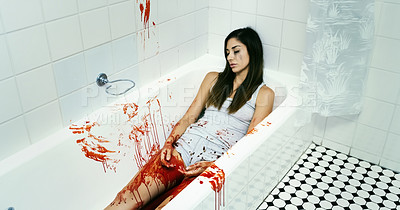 Buy stock photo Cropped shot of a dead body lying in a pool of blood in a bathtub