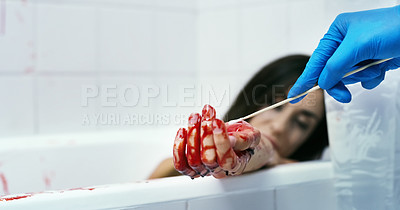 Buy stock photo Cropped shot of an unrecognizable official inspecting a dead body on a crime scene